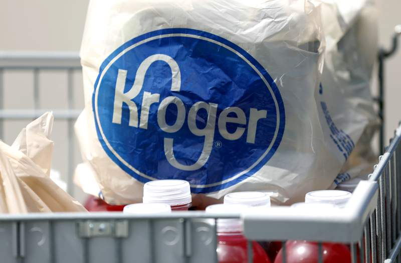 FILE-  file photo, bagged purchases from a Kroger grocery store sit in a shopping cart