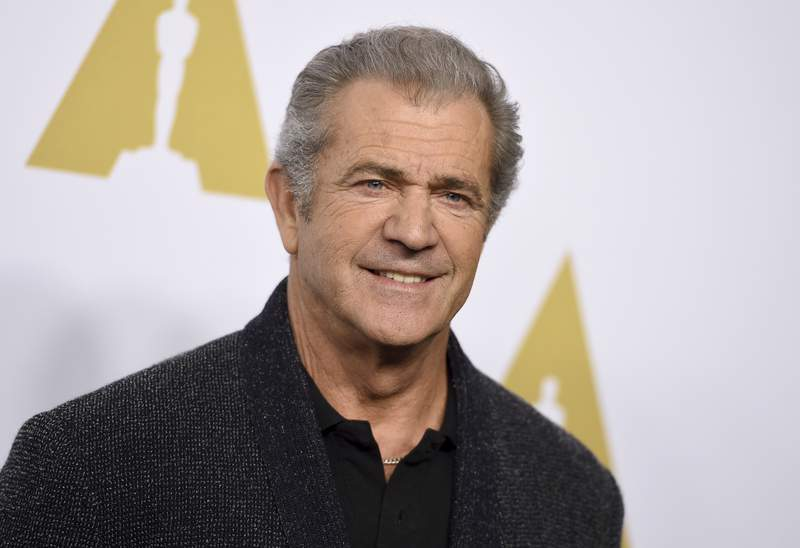 FILE - Mel Gibson arrives at the 89th Academy Awards Nominees Luncheon in Beverly Hills, Calif. on Feb. 6, 2017. Gibson spent a week in a Los Angeles hospital in April after testing positive for COVID-19, his representative said Friday. The 64-year-old actor and director has since completely recovered and is doing great according to the rep. He also said Gibson has tested negative numerous times since then. Gibson is the latest in a long string of high profile figures to go public with their coronavirus diagnoses and recoveries including Tom Hanks, Rita Wilson, George Stephanopoulos and the singer Pink. (Photo by Jordan Strauss/Invision/AP, File)