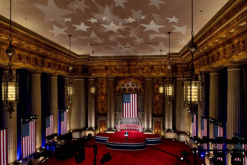 Eric Trump, the son of President Donald Trump, tapes his speech for the second day of the Republican National Convention from the Andrew W. Mellon Auditorium in Washington, Tuesday, Aug. 25, 2020. (AP Photo/Andrew Harnik)