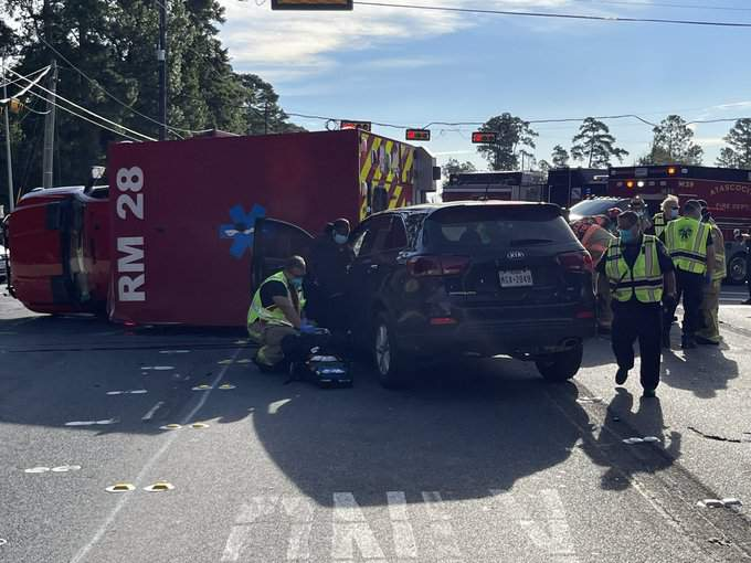 Authorities are working to clear the scene of a multi-vehicle crash involving an ambulance in northeast Harris County.