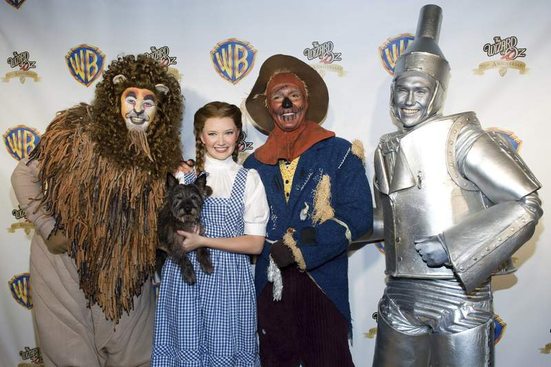 "FILE - Costumed ""Wizard of Oz"" characters attend the ""Wizard of Oz"" 70th Anniversary Emerald Gala on Sept. 24, 2009, in New York. New Line Cinema is making a new adaptation of The Wonderful Wizard of Oz, the L. Frank Baum childrens novel, with Nicole Kassell, the visual architect of Watchmen, set to direct. (AP Photo/Charles Sykes, File)"