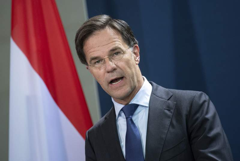 FILE - In this Thursday July 9, 2020 file photo, Mark Rutte, Prime Minister of the Netherlands, talks during a media conference at the Federal Chancellery in Berlin. Rutte said Friday, Nov. 6, 2020 that threats that forced a teacher in the port city of Rotterdam to go hiding after some students objected to a political cartoon displayed in his classroom must not be tolerated. Rutte spoke Friday hours after Rotterdam police said they had arrested an 18-year-old girl. (Bernd von Jutrczenka/Pool via AP, file)