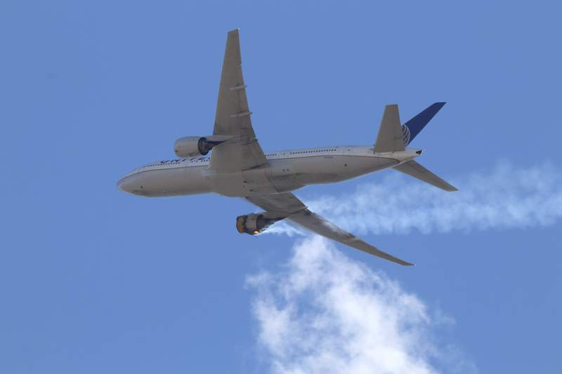 "This Saturday, Feb. 20, 2021 photo provided by Hayden Smith shows United Airlines Flight 328 approaching Denver International Airport, after experiencing ""a right-engine failure"" shortly after takeoff from Denver. Federal regulators are investigating what caused a catastrophic engine failure on the plane that rained debris on Denver suburbs as the aircraft made an emergency landing. Authorities said nobody aboard or on the ground was hurt despite large pieces of the engine casing that narrowly missed homes below. (Hayden Smith via AP)"