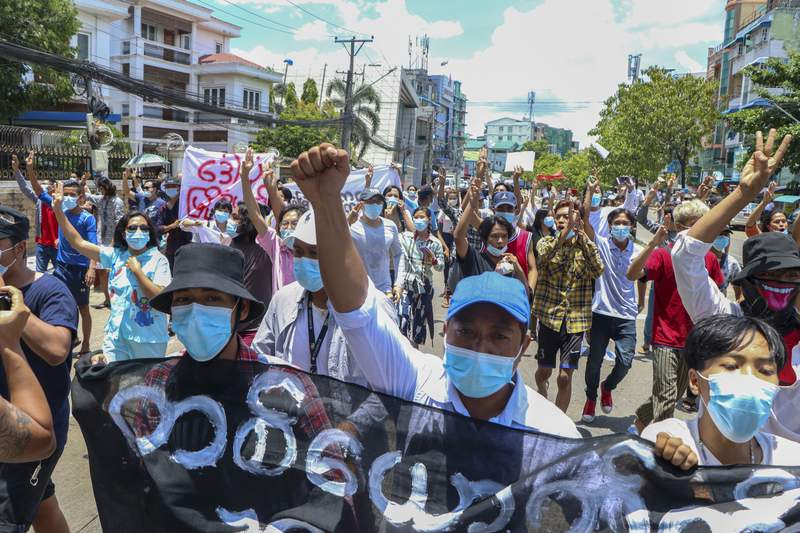 FILE - In this May 12, 2021, file photo, anti-coup protesters march during a demonstration in Yangon, Myanmar. Myanmars military rulers are seeking to limit access to the internet to an internal network of only whitelisted sites to quash widespread opposition to their seizure of power, according to a report by the International Crisis Group. (AP Photo, File)
