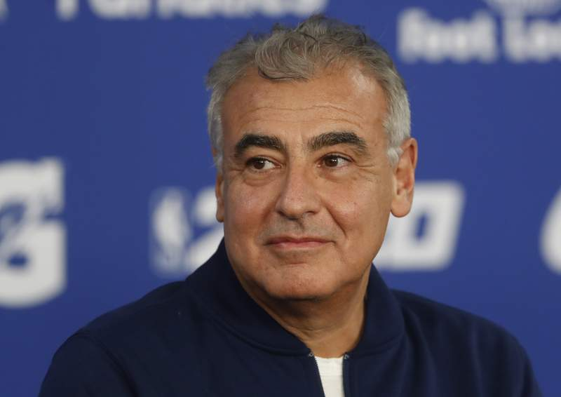 FILE - In this Jan. 24, 2020, file photo, Marc Lasry, co-owner of the NBA's Milwaukee Bucks attends a press conference ahead of NBA basketball game between Charlotte Hornets and Milwaukee Bucks in Paris. Lasry, the hedge-fund billionaire and Milwaukee Bucks co-owner who was named chairman of embattled media organization Ozy earlier this month, has resigned from its board.  (AP Photo/Thibault Camus, File)