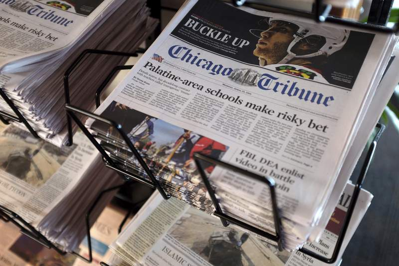 FILE - In this Monday, April 25, 2016, file photo, Chicago Tribune and other newspapers are displayed at Chicago's O'Hare International Airport.  Hedge fund Alden, Tribunes largest shareholder, has offered to buy the rest of the newspaper publisher, Thursday, Dec. 31, 2020,  at a price that values it at $520.6 million.   (AP Photo/Kiichiro Sato, File)