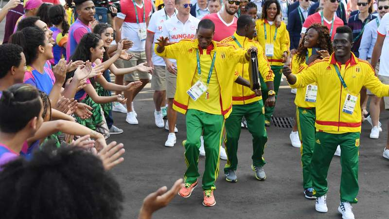 Athletes from the Republic of Guinea dance during a welcoming ceremony at the Olympic Village ahead of the Rio 2016 Olympic Games in Rio de Janeiro, on August 4, 2016.