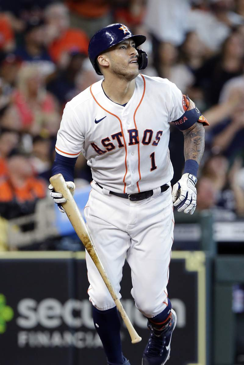 Houston Astros' Carlos Correa watches his two-run home run during the fourth inning of a baseball game against the San Diego Padres, Saturday, May 29, 2021, in Houston. (AP Photo/Michael Wyke)