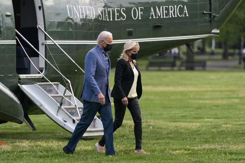 President Joe Biden walks from Marine One with first lady Jill Biden on the Ellipse near the White House after spending the weekend in Wilmington, Del., Sunday, April 25, 2021, in Washington. (AP Photo/Manuel Balce Ceneta)
