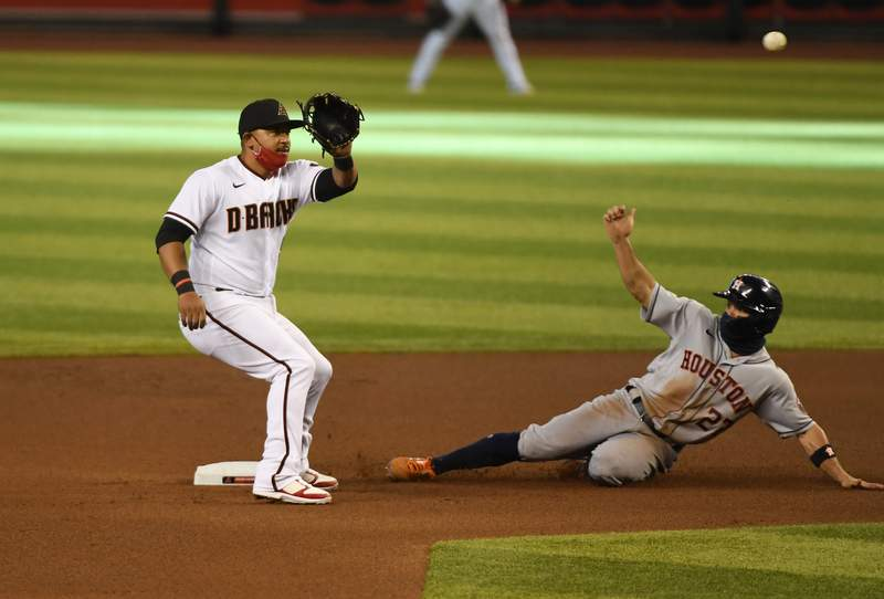 PHOENIX, ARIZONA - AUGUST 06: Jose Altuve #27 of the Houston Astros safely steals second base as Eduardo Escobar #5 of the Arizona Diamondbacks waits for the throw from catcher Carson Kelly #18 during the fourth inning at Chase Field on August 06, 2020 in Phoenix, Arizona. (Photo by Norm Hall/Getty Images)