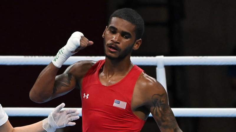 U.S. boxer Delante Johnson celebrates his victory over Argentina's Brian Agustin Arregui at the 2020 Tokyo Olympic Games.