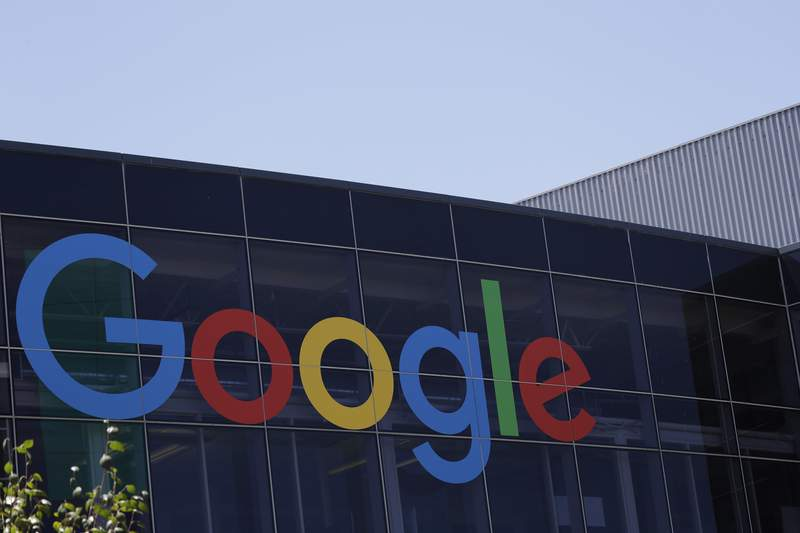 FILE - This July 19, 2016 file photo shows the Google logo at the company's headquarters in Mountain View, Calif. Italian regulators opened an investigation Wednesday, Oct. 28, 2020 into Google over alleged abuse of its dominant role in the country's online ad market, adding to the global scrutiny that the Silicon Valley company is facing. (AP Photo/Marcio Jose Sanchez, File)