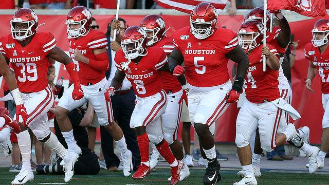 The Houston Cougars take the field for a football game against the Prairie View A&M Panthers on September 07, 2019, in Houston, Texas.