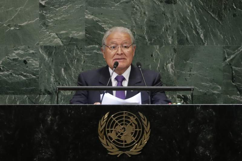 FILE - In this Sept. 26, 2018 file photo, El Salvador's President Salvador Sanchez Ceren addresses the 73rd session of the United Nations General Assembly at U.N. headquarters. Prosecutors in El Salvador have issued an arrest warrant for Snchez Cern in July 2021 on charges of embezzlement and money laundering, according to Attorney General Rodolfo Delgado on Thursday, July 22, 2021.  (AP Photo/Frank Franklin II, File)