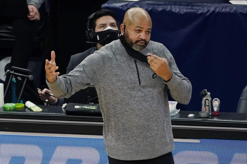 Cleveland Indians head coach J B.Bickerstaff directs his team in the second half of an NBA basketball game against the Minnesota Timberwolves, Sunday, Jan. 31, 2021, in Minneapolis. (AP Photo/Jim Mone)
