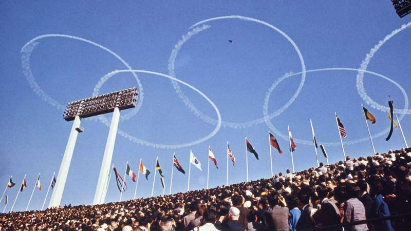 Olympic rings are formed in the sky by planes of the Japanese Self Defense Forces during opening ceremonies of the 1964 Summer Olympics in Tokyo, Japan.