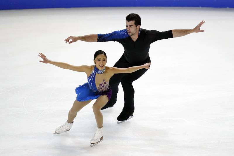 FILE - In this Jan. 16, 2021, file photo, Jessica Calalang and Brian Johnson perform during the pairs free skate program at the U.S. Figure Skating Championships in Las Vegas. Calalang, a U.S. pairs skater and potential member of the team for next February's Winter Games in Beijing, recently had a suspension from the sport overturned. Calalang had tested positive for a banned substance in January at the national championships, and it took eight months for her name to be cleared. (AP Photo/John Locher, File)