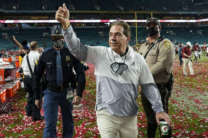 FILE - Alabama head coach Nick Saban leaves the field after their win against Ohio State in an NCAA College Football Playoff national championship game in Miami Gardens, Fla., in this Tuesday, Jan. 12, 2021, file photo. Saban, who has won a record seven national championships, has agreed to a three-year contract extension running through the 2029 season. Alabama announced the extension on Monday, June 7, 2021, including $8.425 million in base salary and talent fee for the current contract year with annual raises of unspecified amounts. (AP Photo/Lynne Sladky, File)