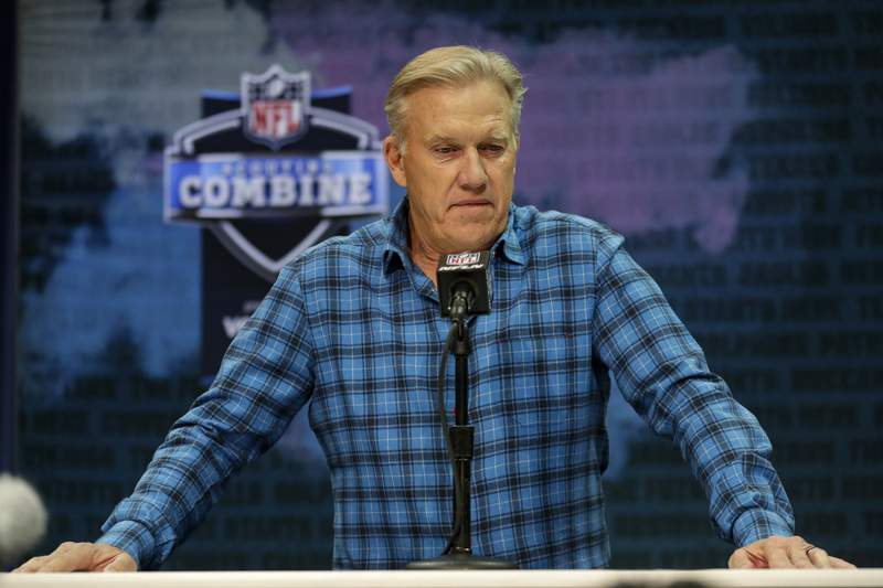 FILE - In this Feb. 25, 2020, file photo, Denver Broncos general manager John Elway speaks during a news conference at the NFL football scouting combine in Indianapolis. Elway announced a major change in the Broncos football operations Monday, Jan. 4, 2021, saying he will hire a general manager who will report to him but have final say on the draft, free agency and the roster. Elway, who has been GM since 2011, will remain as president of football operations in 2021, the final year of his contract. (AP Photo/Michael Conroy, File)