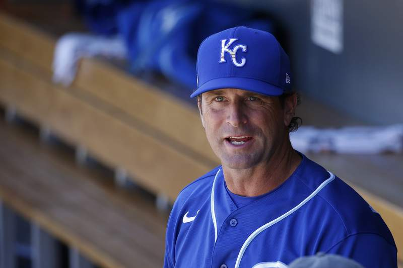 """FILE - In this March 9, 2020, file photo, Kansas City Royals manager Mike Matheny pauses in the dugout prior to a spring training baseball game against the Arizona Diamondbacks in Scottsdale, Ariz. Forget about those halcyon first few days of spring training, when arranging for the right tee time on the right golf course is often more challenging than the work on the field. When major leaguers report next week for spring training 2.0  or perhaps more accurately, baseball's first summer camp  time will be one precious commodity with about three weeks before opening day. We're going to have some live batting practices the first day they show up. Day 1 and Day 2. ... Multiple ups for the starters,"""" Matheny said Friday, June 26, 2020, on a video conference call. These guys are prepared for that. They've been hungry for it. (AP Photo/Ross D. Franklin, File)"""