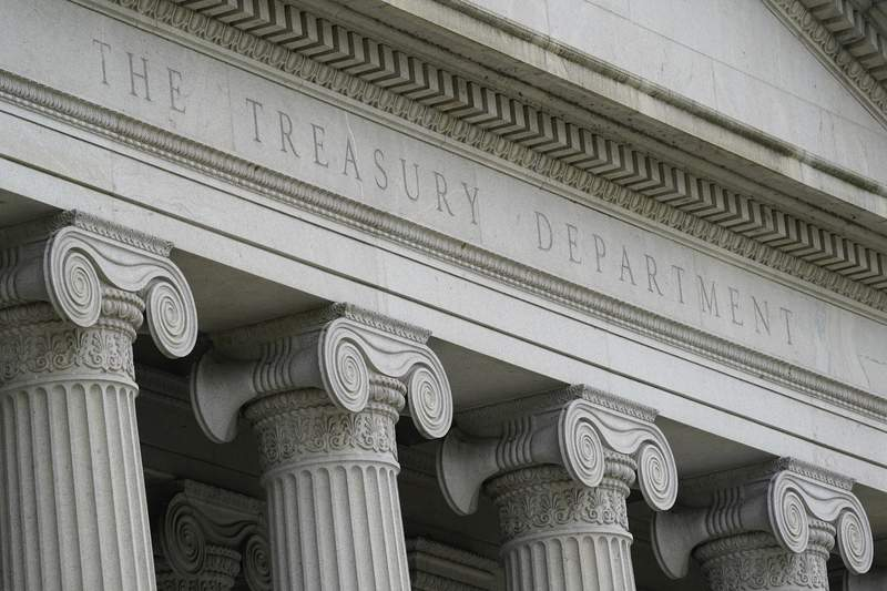 FILE - This May 4, 2021, photo shows the Treasury Building in Washington. The U.S. government's deficit for the first nine months of this budget year hit $2.24 trillion, keeping the country on track for its second biggest shortfall in history.  In its monthly budget report, the Treasury Department said Tuesday, July 13 that the deficit for the budget year that ends in September is running 9.1% below last year's pace. (AP Photo/Patrick Semansky, File)