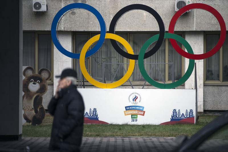 FILE - In this Nov. 28, 2019 file photo Olympic Rings and a model of Misha the Bear Cub, the mascot of the Moscow 1980 Olympic Games, left, are seen in the yard of Russian Olympic Committee building in Moscow, Russia. In the report detailing its decision to shorten Russia's ban from the Olympics, the highest court in sports blasted that country's leaders for engaging in a cover up of the cover-up in a desperate attempt to deny their culpability, but reduced the punishment nonetheless, Wednesday, Jan. 13, 2021. (AP Photo/Pavel Golovkin, file)
