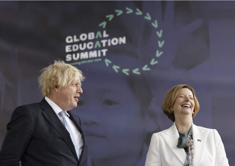 Britain's Prime Minister Boris Johnson alongside former PM of Australia Julia Gillard during a summit to raise funds for the Global Partnership for Education (GPE), in London Thursday July 29, 2021.  The UK last month pledged 430 million pounds (dollars 700 million US) to the project, which aims to secure at least five billion US dollars over the next five years. (Tolga Akmen/PA via AP)
