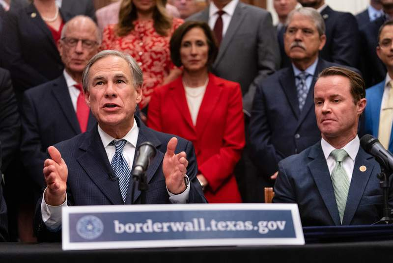 From left: Gov. Greg Abbott and House Speaker Dade Phelan gave updates on their plan for Texas to build its own border wall at a press conference at the Texas Capitol on June 16, 2021.