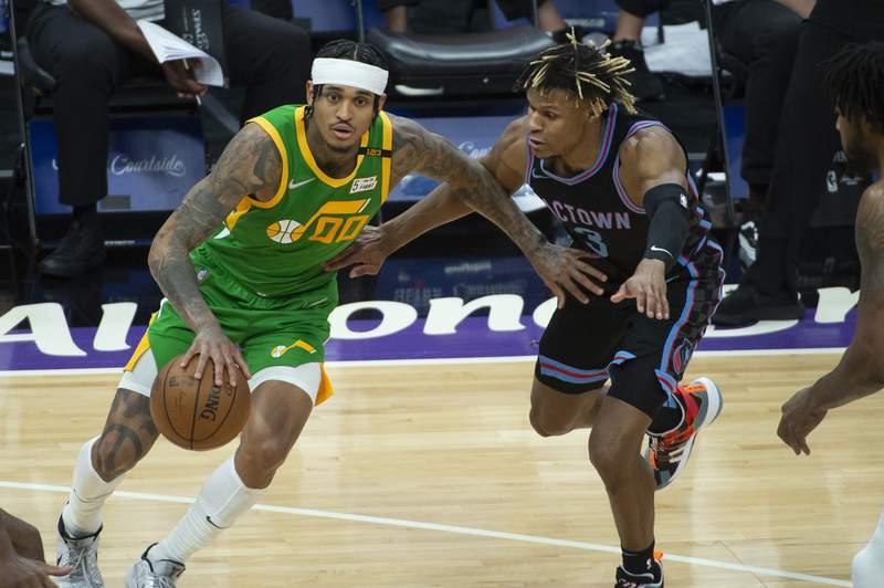 Utah Jazz guard Jordan Clarkson (00) is guarded by Sacramento Kings guard Jahmi'us Ramsey (3) during the second half of an NBA basketball game in Sacramento, Calif., Sunday, May 16, 2021. The Jazz won 121-99. (AP Photo/Randall Benton)