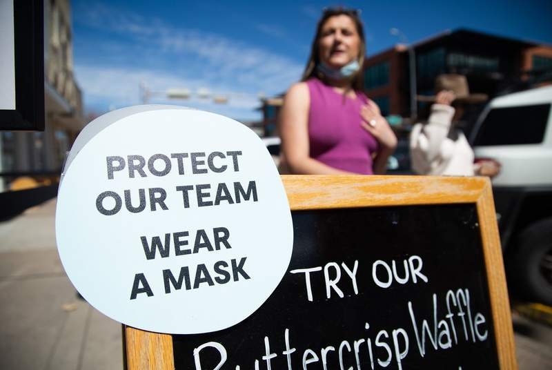 A sign in South Austin asks customers to wear a mask inside ta business on March 3, 2021.