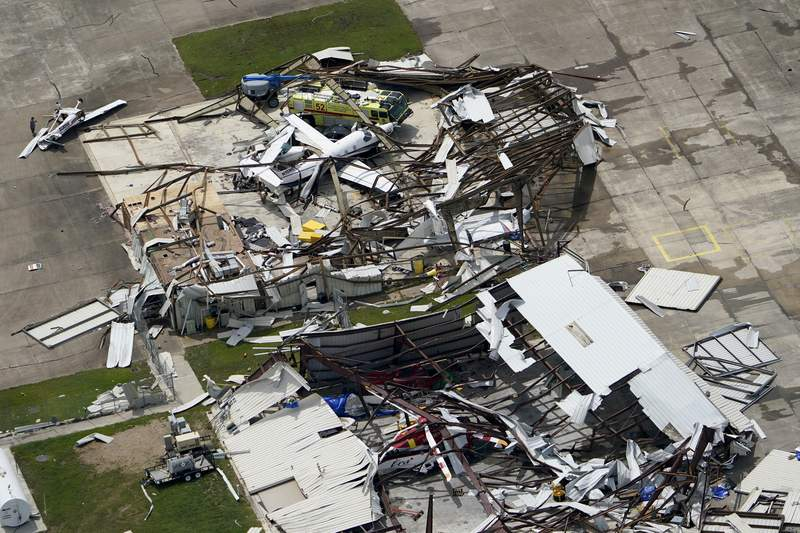 A airplane hangar is destroyed Thursday, Aug. 27, 2020, after Hurricane Laura went through the area near Lake Charles, La. (AP Photo/David J. Phillip)