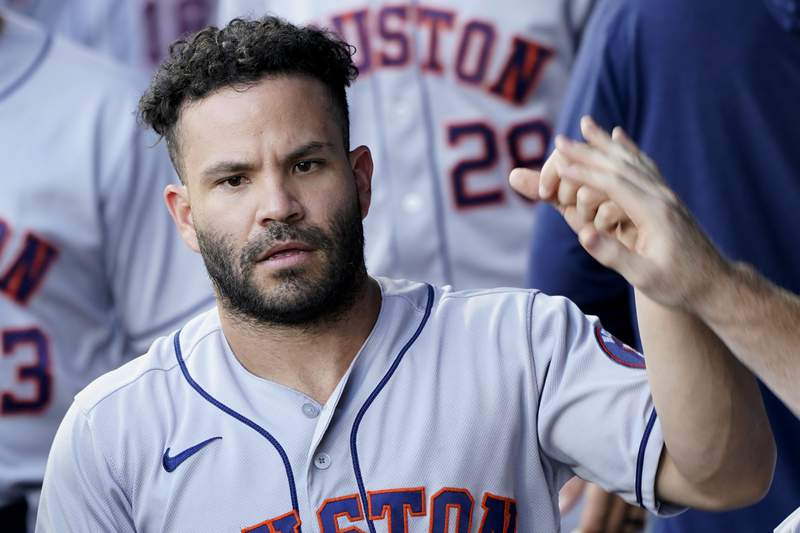 Houston Astros' Jose Altuve celebrates in the dugout after scoring on a single by Yordan Alvarez during the first inning of a baseball game against the Kansas City Royals Monday, Aug. 16, 2021, in Kansas City, Mo. (AP Photo/Charlie Riedel)