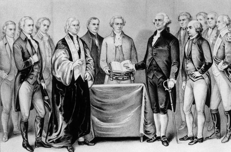 The inauguration of George Washington as the first President of the United States. Also present are (from left) Alexander Hamilton, Robert R. Livingston, Roger Sherman, Mr. Otis, Vice President John Adams, Baron Von Steuben and General Henry Knox. Original Artwork: Printed by Currier & Ives.  (Photo by MPI/Getty Images)