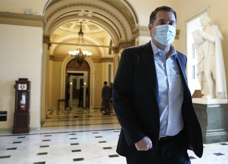 FILE - In this Wednesday, Jan. 13, 2021, file photo, Rep. Devin Nunes, R-Calif., walks at the Capitol in Washington, as the House of Representatives pursues an article of impeachment against President Donald Trump for his role in inciting an angry mob to storm the Capitol last week. A defamation lawsuit Rep. Nunes brought against CNN was tossed out by a Manhattan judge on Friday, Feb. 19. The lawsuit seeking over $435 million in damages was rejected by U.S. District Judge Laura Taylor Swain, who said the California Republican failed to request a retraction in a timely fashion or adequately state his claims. (AP Photo/J. Scott Applewhite, File)