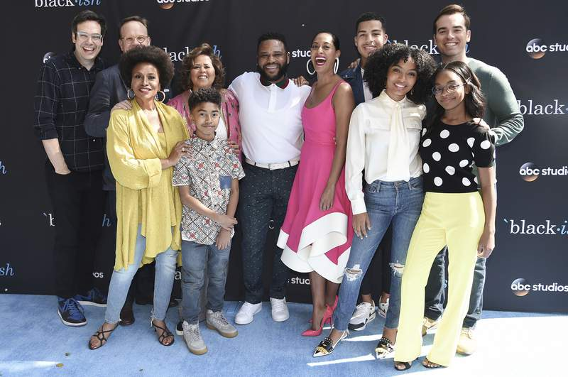 """FILE - In this April 28, 2018 file photo, the cast of """"black-ish"""" attends a For Your Consideration event in Burbank, Calif. Pictured from left are Nelson Franklin, Peter Mackenzie, Jenifer Lewis, Miles Brown, Anna Deavere Smith, Anthony Anderson, Tracee Ellis Ross, Marcus Scribner, Yara Shahidi, Marsai Martin and Jeff Meacham. ABC is bringing back the lions share of its series for next season, including black-ish, A Million Little Things and The Rookie. Those are among the shows that will return in the 2020-21 season, the network said Thursday, adding to the list of previously announced renewals for a total so far of 19. (Photo by Richard Shotwell/Invision/AP, File)"""