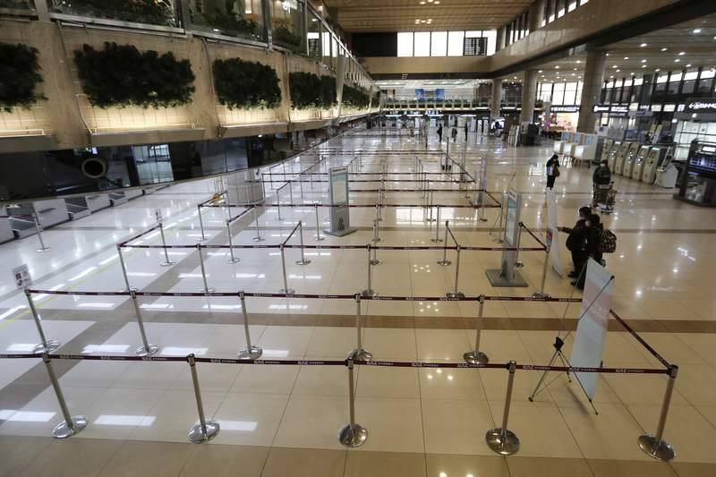 Check-in counters of Japanese airlines are deserted at Gimpo Airport in Seoul, South Korea, Saturday, March 7, 2020. South Korea announced it will end visa-free entry for Japanese citizens starting Monday in retaliation for a two-week quarantine imposed by Japan on all visitors from South Korea because of its surging viral outbreak. (AP Photo/Ahn Young-joon)