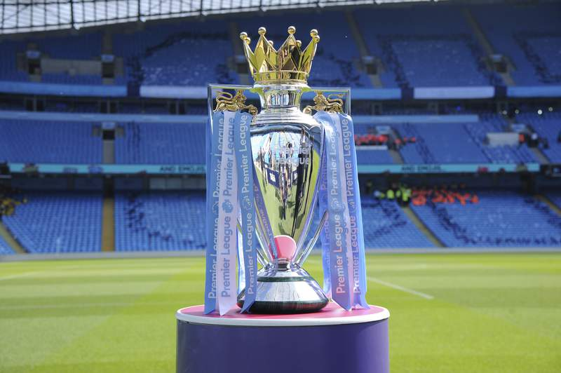 FILE - In this Sunday, May 6, 2018 file photo, the English Premier League trophy is displayed on the pitch prior to the English Premier League soccer match between Manchester City and Huddersfield Town at Etihad stadium in Manchester, England. A Bournemouth player is one of two positive tests for COVID-19 to emerge from the Premier Leagues second round of testing, the club said on Sunday, May 24, 2020. The team said medical confidentiality means the players name will not be disclosed and added that he will self-isolate for seven days before being tested again at a later date. The league tested 996 players and club staff on Tuesday, Thursday, and Friday.  (AP Photo/Rui Vieira, File)