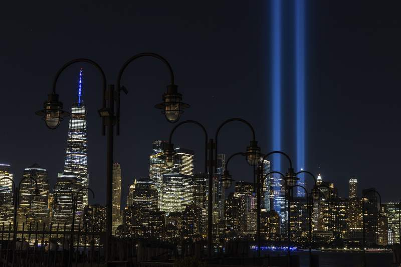 FILE - In this Sept. 11, 2020, file photo tribute in Light, two vertical columns of light representing the fallen towers of the World Trade Center shine against the lower Manhattan skyline on the 19th anniversary of the Sept. 11, 2001, terror attacks, seen from Jersey City, N.J. As the 20th anniversary of the Sept. 11, 2001, terrorist attacks approaches, Americans increasingly balk at intrusive government surveillance in the name of national security, and only about a third believe that the wars in Afghanistan and Iraq were worth fighting, according to a new poll by The Associated Press-NORC Center for Public Affairs Research. (AP Photo/Stefan Jeremiah, File)