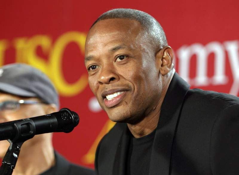 """FILE - This May 15, 2013 file photo shows hip-hop mogul Dr. Dre as he announces a $70 million dollar donation to create the new """"Jimmy Iovine and Andre Young Academy for Arts and Technology and Business Innovation,"""" at the University of Southern California, in Santa Monica, Calif. Music mogul Dr. Dre was back at home Saturday, Jan 16, 2021, after being treated at a Los Angeles hospital for a reported brain aneurysm. Peter Paterno, an attorney for the rapper and producer, said Dre was home but offered no other details in an email exchange Saturday.  (AP Photo/Damian Dovarganes, File)"""