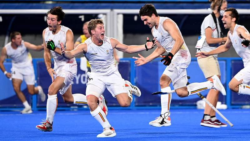 The Belgian players celebrate victory after winning the gold medal final match over Australia