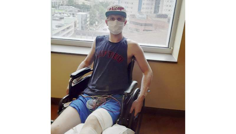 """This July 2021 photo provided by Preston Browning shows him at the Vanderbilt Medical Center in Nashville, Tenn. Browning, 20, of Ridgetop, Tenn., who is recovering from cancer surgery, quit smoking with help from Vanderbilt Ingram Cancer Center. He says cancer is """"the biggest reason I've ever had in my life to quit."""" (Courtesy Preston Browning via AP)"""