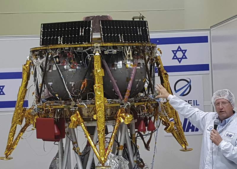 FILE - In this July 10, 2018 file photo, Opher Doron, general manager of Israel Aerospace Industries' space division, speaks beside the SpaceIL lunar module, during a press tour of their facility near Tel Aviv, Israel. SpaceIL, the nonprofit Israeli initiative whose spacecraft crashed on the moon two years ago, said Sunday,, July 11, 2021 that it has secured $70 million in funding to make a second attempt at a lunar landing. (AP Photo/Ilan Ben Zion, File)