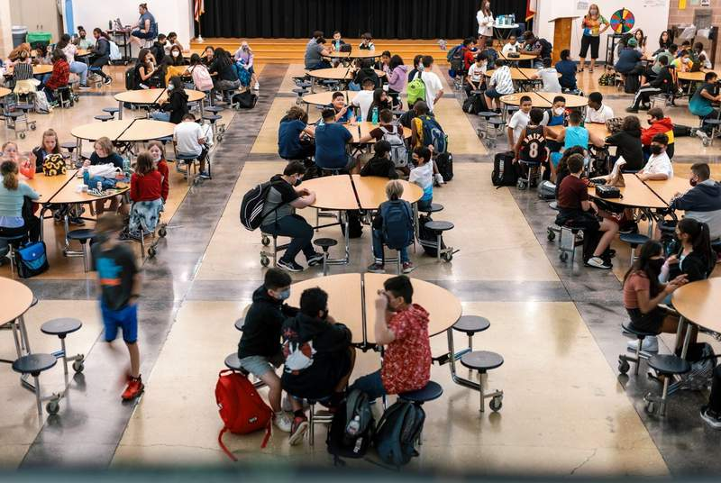 Students eat lunch in the cafeteria at Chapa Middle School in Kyle on Aug. 24, 2021.