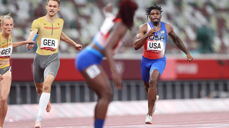 TOKYO, JAPAN - JULY 30: Elija Godwin of Team United States competes in the Mixed 4x400 metres relay round 1 on day seven of the Tokyo 2020 Olympic Games at Olympic Stadium on July 30, 2021 in Tokyo, Japan. (Photo by Michael Steele/Getty Images)