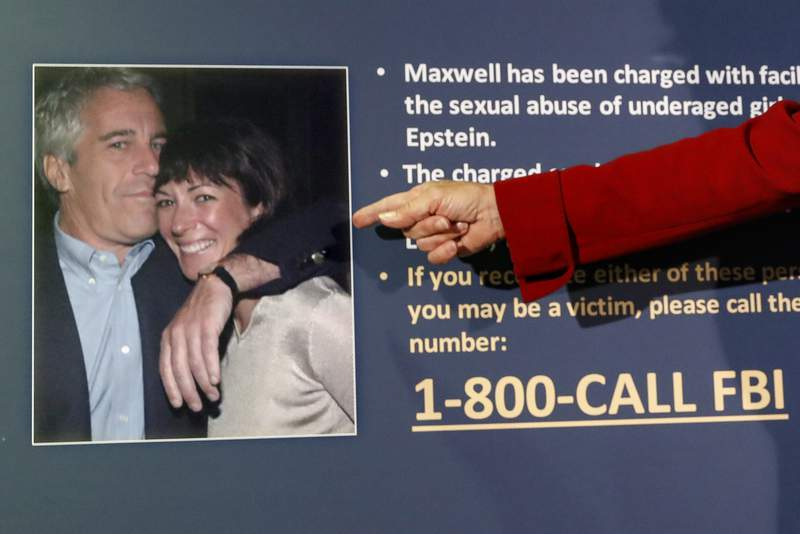 """FILE - In this July 2, 2020, file photo, Audrey Strauss, acting United States Attorney for the Southern District of New York, points to a photo of Jeffrey Epstein and Ghislaine Maxwell during a news conference, in New York. Transcripts released Thursday show the ex-girlfriend of financier Jeffrey Epstein was combative and defensive under tough questioning four years ago about her ex-boyfriends interactions with underage girls. Ghislaine Maxwell said she """"never saw any inappropriate underage activities with Jeffrey ever."""" (AP Photo/John Minchillo, File)"""
