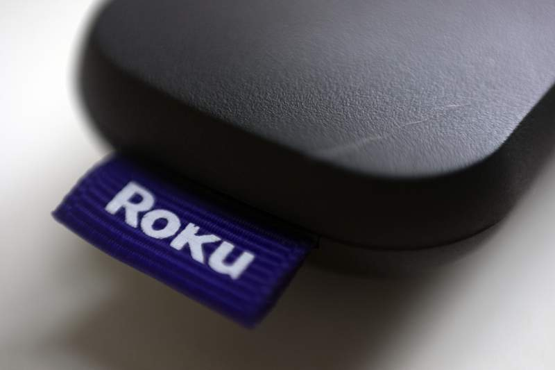 FILE - This Aug. 13, 2020 file photo shows a logo for Roku on a remote control in Portland, Ore.  On Friday, Jan. 8, 2021, Roku is buying short-lived streaming service Quibis content library to bolster content for its free Roku Channel. Financial terms were undisclosed.  AP Photo/Jenny Kane, File)
