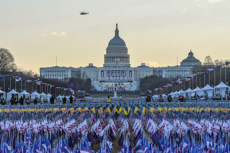 Marine One carrying President Donald Trump and first lady Melania Trump as they departed from the White House flies over the U.S. Capitol ahead of the inauguration of U.S. President-elect Joe Biden on January 20, 2021 in Washington, DC. (Photo by Stephanie Keith/Getty Images)