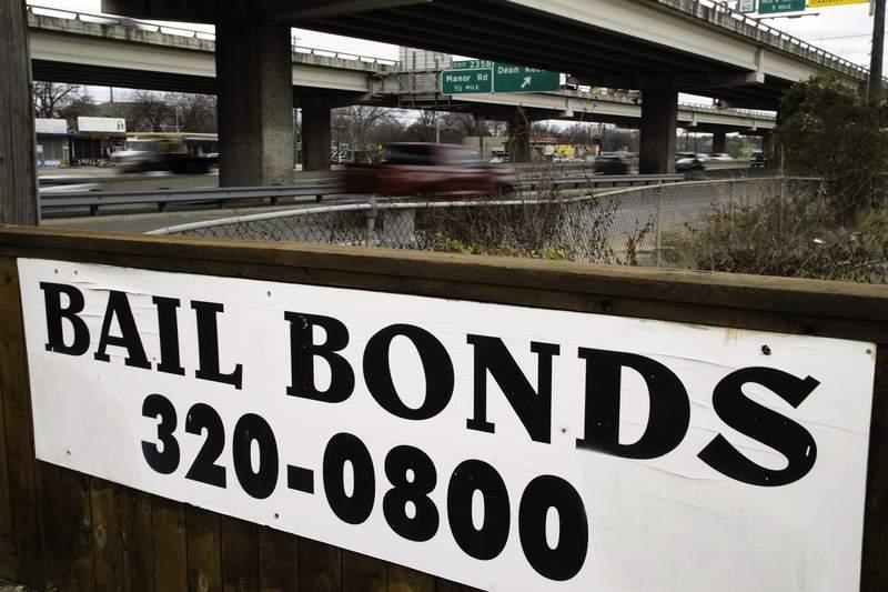 An Austin Bail Bonds II sign near Interstate 35 on Feb. 5, 2021.