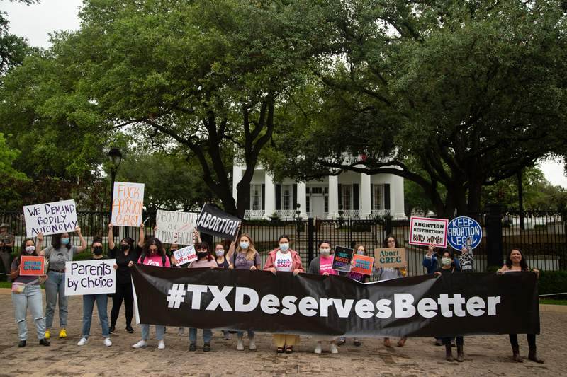Protestors gather in front of the Governer's mansion in Austin to protest against SB 8, an anti-abortion bill in the senate, on May 19, 2021.