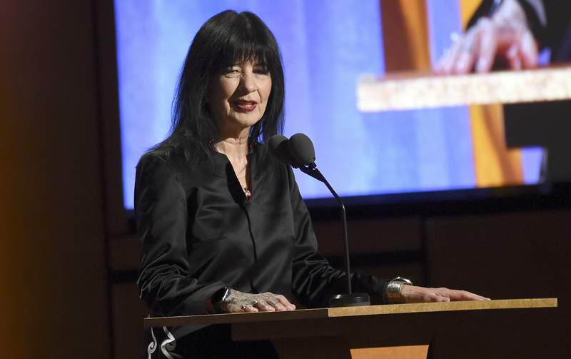 FILE - U.S. poet laureate Joy Harjo speaks at the Governors Awards on Oct. 27, 2019, in Los Angeles. Harjo will serve a third 1-year term and has launched an online project that celebrates Native American poets around the country. Her re-appointment was announced Thursday, Nov. 19, 2020, by the Library of Congress, and her new term begins in September. (Photo by Chris Pizzello/Invision/AP, File)